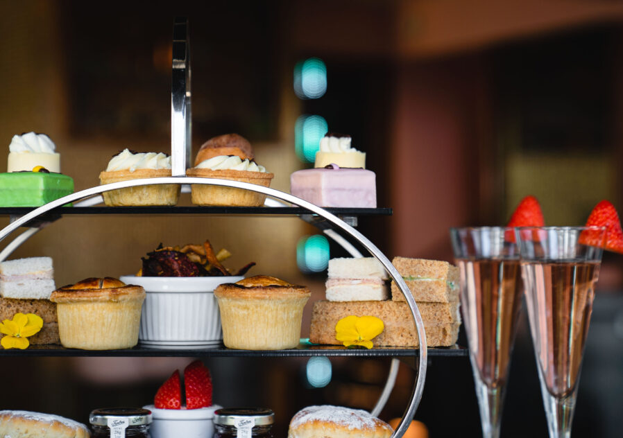 2 glasses of pink prosecco and strawberries which are served with our ultimate afternoon tea.