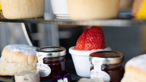 Our ultimate afternoon tea comes served with jam, cream, butter & strawberries - perfect for the warm fruit scones.